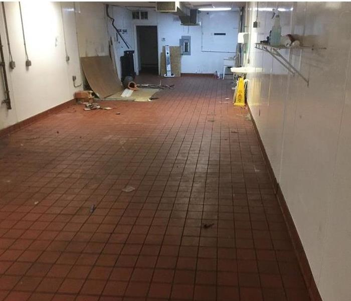 Large room with tile flooring that is dry.