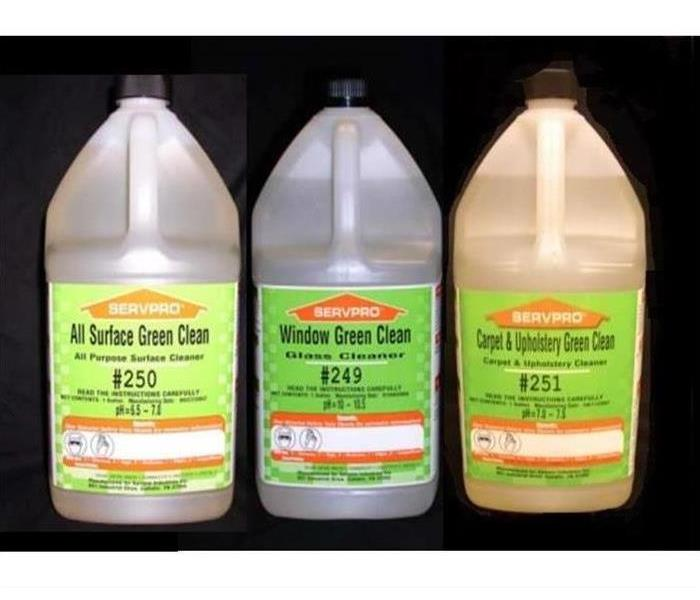 Three containers of cleaning products with SERVPRO labels.
